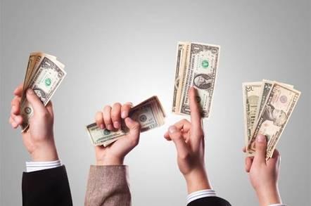 hands waving dollar bills in the air
