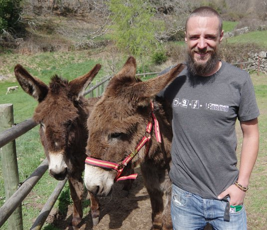 Matthew with our new shirt and two donkeys