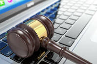 GAVEL ON A LAPTOP KEYBOARD