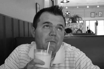 Man drinking through a straw CC2.0 attribution Bradley Gordon https://www.flickr.com/photos/icanchangethisright/