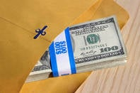 Cash in brown paper envelope CC 2.0 attribution StockMonkeys.com