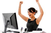 happy_woman_at_desk