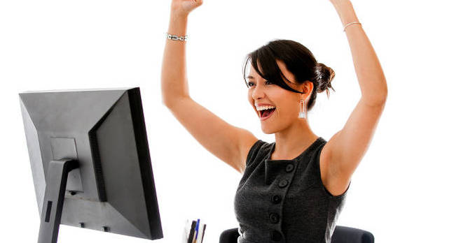 happy_woman_at_desk