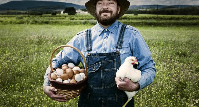 Free range chicken and farmer photo via Shutterstock