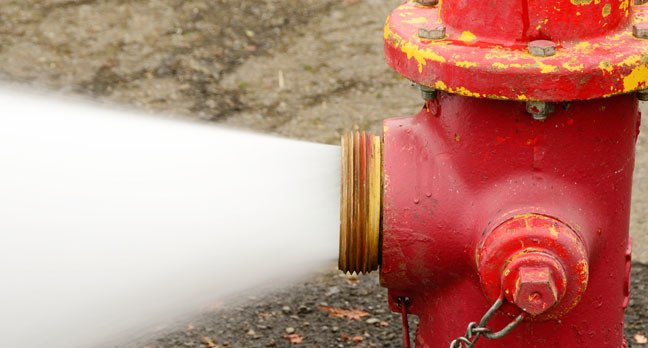 gushing fire hydrant, photo via Shutterstock