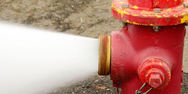 gushing fire hydrant, photo via Shutterstock