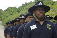 Nauru police cadets queue in uniform.