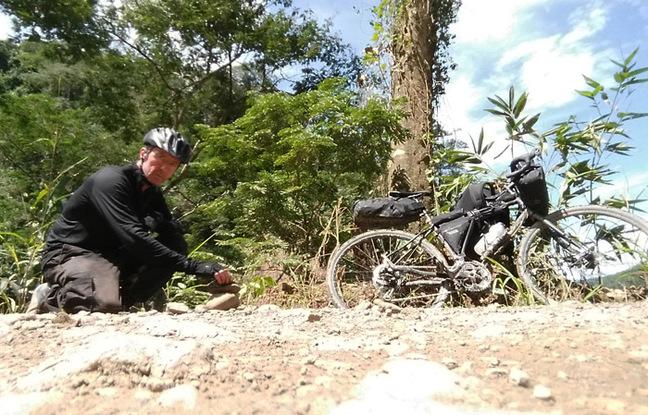 Gavin and his bike on a jungle trail