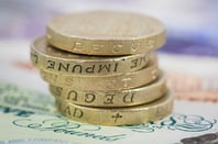 Old pound coins in a stack