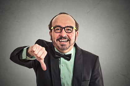 Man thumbs down, image via Shutterstock
