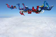 Parachutists and cloud image via Shutterstock