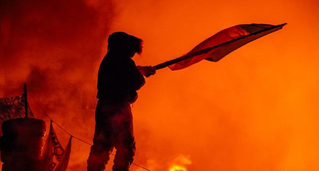 Protestor barricade image via Shutterstock