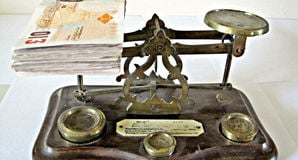 Cash on scales. Pic: Images Money, Flickr