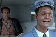 Johnnycab with Arnie. Screen shot from Total Recall