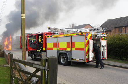 A bus on fire in Whaddon