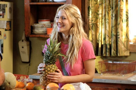 Drew Barrymore holding a pineapple in 50 First Dates