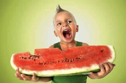 Boy slurps watermelon. Credit: Shutterstock