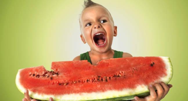 Boy slurps watermelon. Credit: Shutterstock