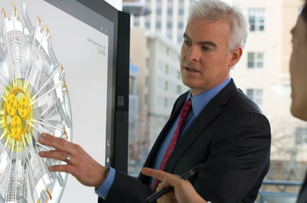 Two people manipulate a CAD design on a Microsoft Surface Hub