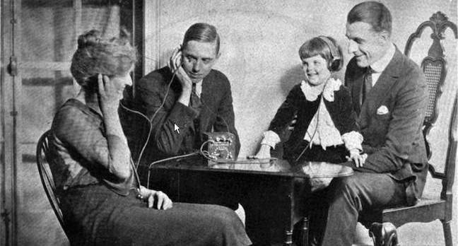 A family listening to a crystal radio set