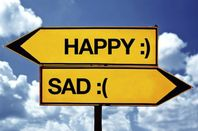 Signpost saying Happy Sad