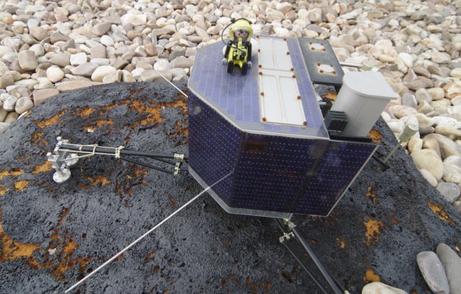 Our plucky Playmonaut atop a model of the Philae lander