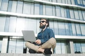 Hipster with laptop photo via Shutterstock