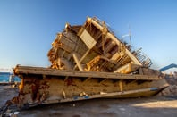 Ship scrapyard photo via Shutterstock