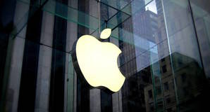 Apple logo on glass fronted building. Licensed under cc0 / editorial use only