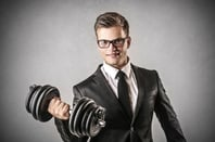 Suit lifting weight, photo via Shutterstock