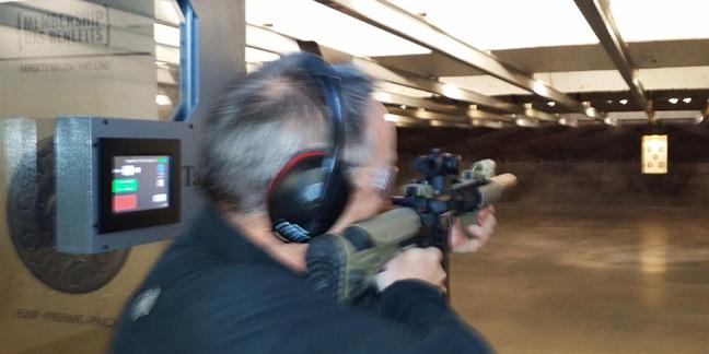 Lester firing an AR-15 assault rifle