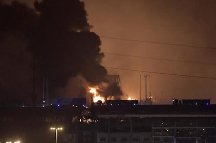 Smoke and fire are seen after an explosion in the Binhai New Area in north China's Tianjin Municipality on Aug. 13, 2015. An explosion rocked the Binhai New Area in north China's Tianjin Municipality at around 11:30 p.m. Wednesday. The cause and casualties are not immediately known. (Xinhua/Yue Yuewei)