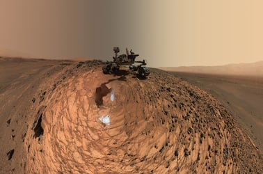 "his low-angle self-portrait of NASA's Curiosity Mars rover shows the vehicle at the site from which it reached down to drill into a rock target called ""Buckskin."" The MAHLI camera on Curiosity's robotic arm took multiple images on Aug. 5, 2015, that were stitched together into this selfie. Credit: NASA/JPL-Caltech/MSSS"