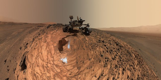 """his low-angle self-portrait of NASA's Curiosity Mars rover shows the vehicle at the site from which it reached down to drill into a rock target called """"Buckskin."""" The MAHLI camera on Curiosity's robotic arm took multiple images on Aug. 5, 2015, that were stitched together into this selfie. Credit: NASA/JPL-Caltech/MSSS"""