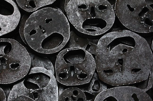 collection of metal masks cut with smiley faces