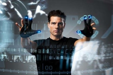 Tom Cruise plays with impressive looking giant touchscreen in still from the movie Minority report (based on book by Phillip K DIck))