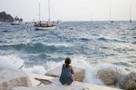 Boats storm girl photo via Nikolina Mrakovic Shutterstock.com