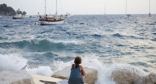 Boats storm girl photo via Nikolina Mrakovic Shutterstock.com