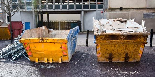Skip full of rubbish outside an office building. Photo via SHUTTERSTOCK