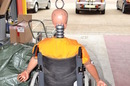 Crash test dummy in a wheel chair at the TRL