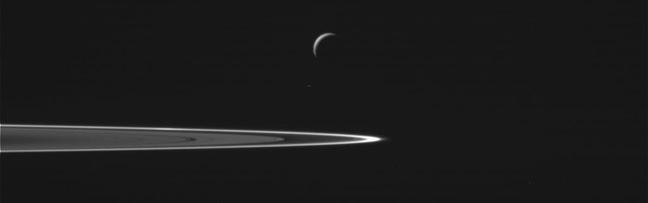 Enceladus and Saturn's rings. Pic: NASA/JPL-Caltech
