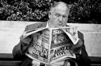Old man reading The Sun. Pic: Daniel Novta