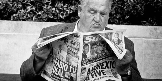 Old man reading The Sun. Pic: Daniel Novta