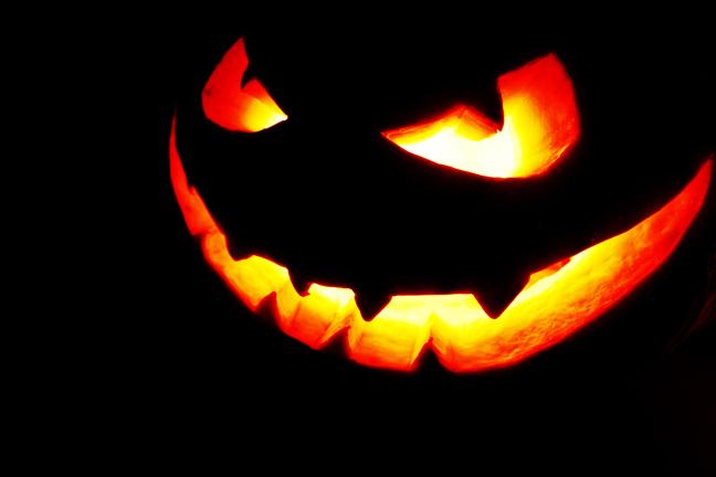 Pumpkin, carved figure via Shutterstock
