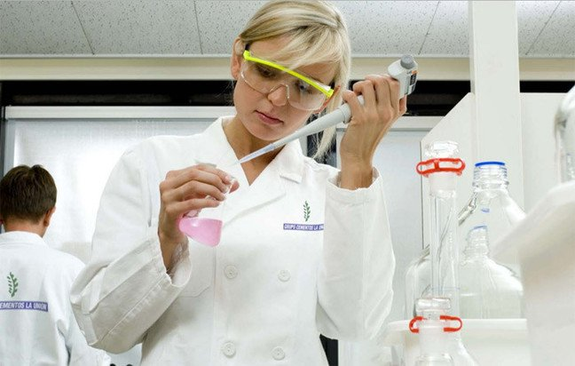 Still from the company's catalogue showing woman scientist in lab