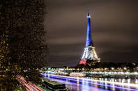 The Eiffel Tower lit in blue white red - Fluctuat nec Mergitur by https://www.flickr.com/photos/la_bretagne_a_paris/ cc 2l0 attribution sharealike https://creativecommons.org/licenses/by-sa/2.0/