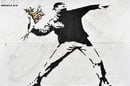 Banksy protester image 1000 words via Shutterstock