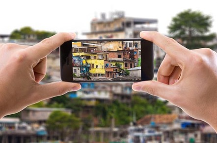 Hand holding smartphone taking picture in Manaus, Brazil. Picture by Filipe Frazao via Shutterstock