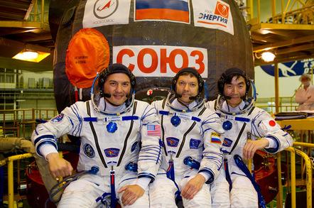 Kjell Lindgren of NASA (left), Oleg Kononenko of the Russian Federal Space Agency (Roscosmos, center) and Kimiya Yui