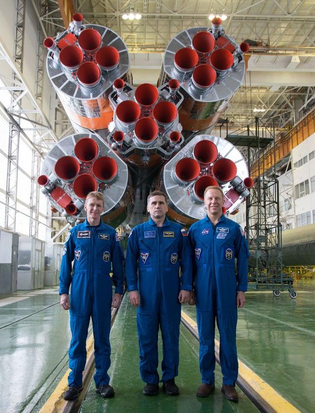 Tim Peake, Yuri Malenchenko and Tim Kopra pose with the Soyuz TMA-19. Pic: Esa